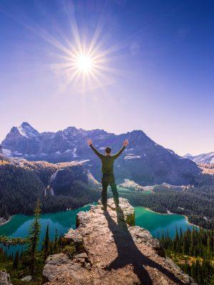 Man at mountain top, Yoho National Park